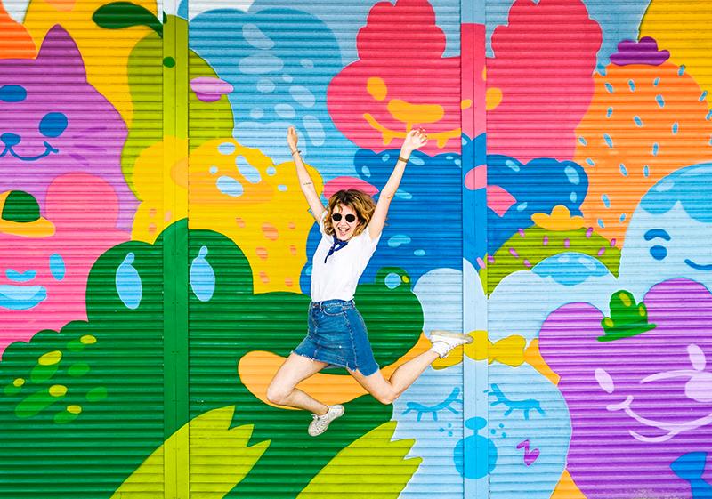VISITFLORIDA TAMPA_WOMAN-JUMPING-MURAL